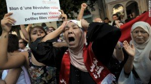 Outraged Tunisians took to the streets by the hundreds Tuesday, angrily protesting the treatment of a woman who was allegedly ...